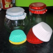 Paper cups for muffins or cupcakes on top of glass jars.