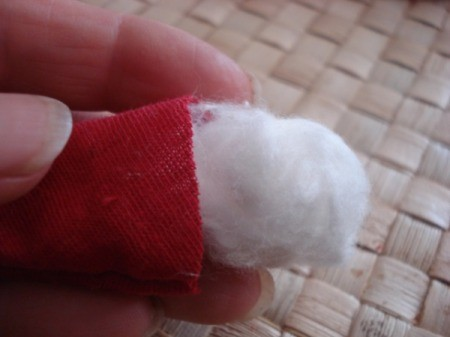 Spool Santa Ornament - gluing on the head using a strip of cotton for head