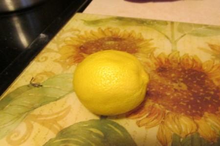 Using Lemon as an Odor Remover - whole lemon on flowered cutting mat