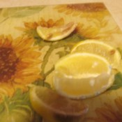 Using Lemon as an Odor Remover - wedges of lemon on a flowered cutting mat