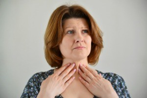 A woman with a sore throat.