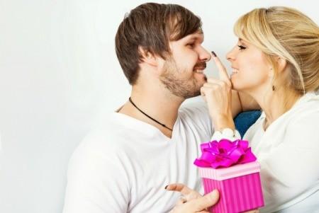 A girl giving her boyfriend an anniversary gift.