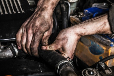 Hands covered in auto grease.