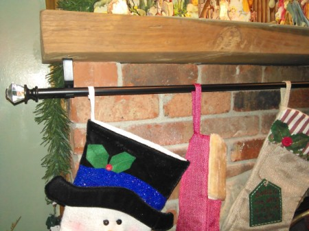 Curtain Rod For Hanging Christmas Stockings - closeup of stockings hanging on rod