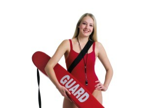A lifeguard holding a flotation device.