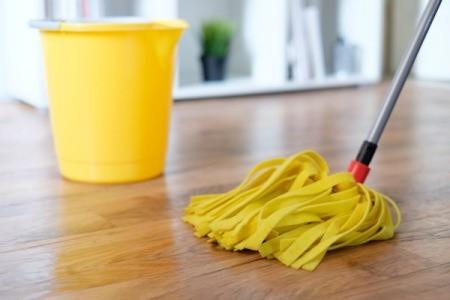 Mopping a hardwood floor.