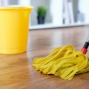 Mopping a hardwood floor.