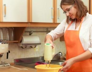 A woman using a mixer.
