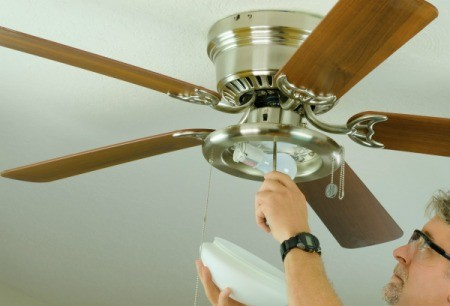 A new ceiling fan being installed.