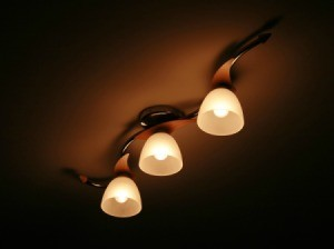 Dim ceiling lights.
