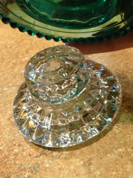 Thriftstore Glass Garden Tower - getting ready to set the insulator on the smaller molded clear candleholder
