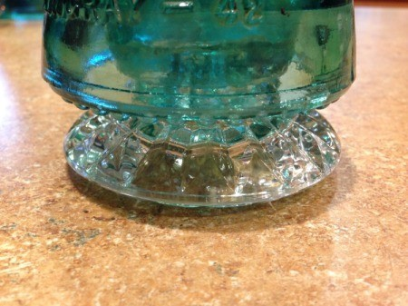 Thriftstore Glass Garden Tower - closeup of the insulator on top of  the candleholder