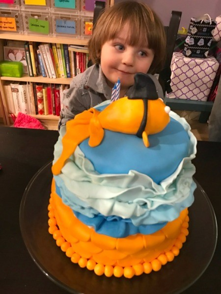 'Sharky' Goldfish Birthday Cake - cake on table in front of birthday boy