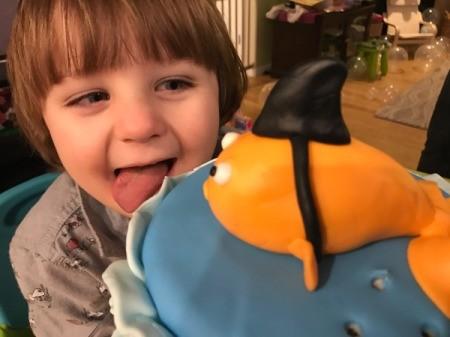 'Sharky' Goldfish Birthday Cake - little boy licking cake