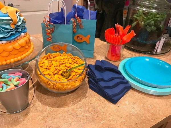 Goldfish Themed Party Snacks - napkins and plates along with partial of cake and snacks