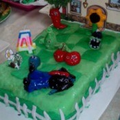 A birthday cake with colored marshmallow fondant.