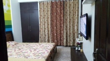 Curtain Color Advice for Multi-colored Wall - view of room with existing curtains