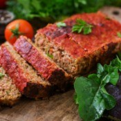 Creole Meat Loaf on a wooden cutting board.