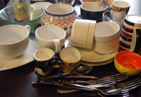 A collection of mismatched dishes from the thrift store.