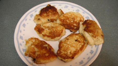 Gluten Free Potato Cakes Browned potato cakes on plate.