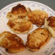 Gluten Free Potato Cakes Browned potato cakes on plate.