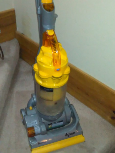 A Dyson vacuum cleaner on a staircase.