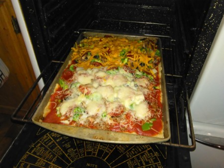 Homemade Pizza on cookie sheet in oven