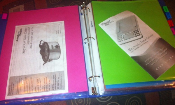 Organizing Home Instruction Manuals - opposing pages of protectors with manuals