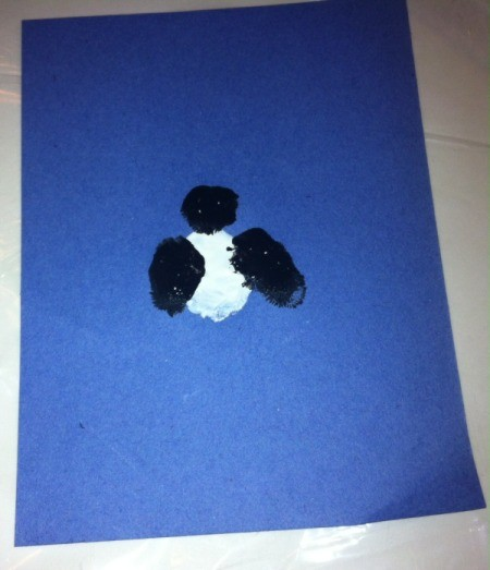 Fingerprint Penguin - use black paint and thumb to make wings and index finger to make the head