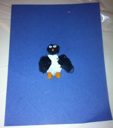 Fingerprint Penguin - use paintbrush with orange paint to make mouth and feet and white and black paint for the eyes