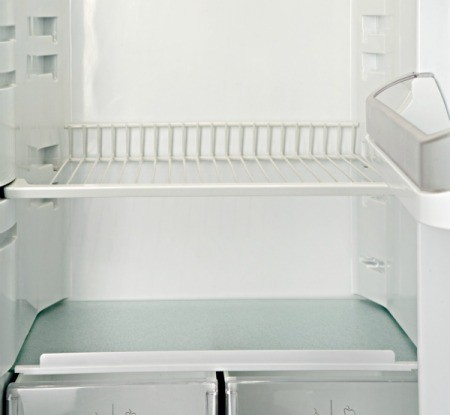 White metal shelf in a refrigerator.