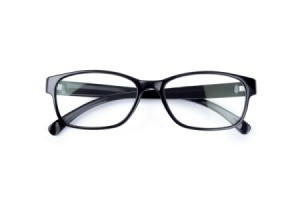Black plastic eyeglasses on a white background.