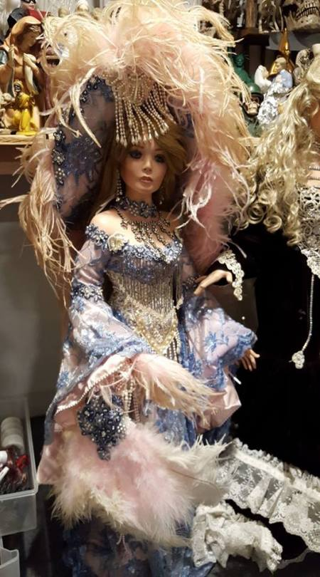 Value of Rustie Dolls  - doll in blue and white lace dress with ornate feather hat