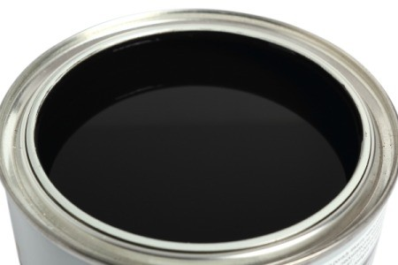 A can of black paint.