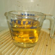 Reuse Vinegar for Cleaning Jobs - cup of vinegar and water in the dirty microwave