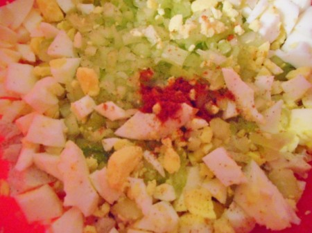 chopped eggs, chicken and celery with spices before mixing