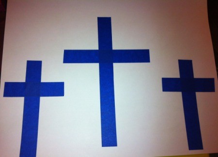 How to Make Cross Silhouettes - three crosses of tape on white paper