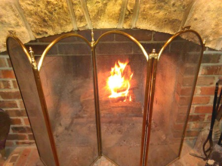 A fireplace with a screen