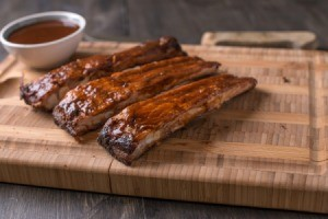 Pork ribs on a cutting board.