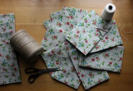 Stiff pieces of floral fabric.