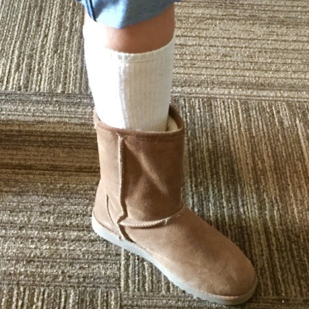 Socks and boots on a leg.