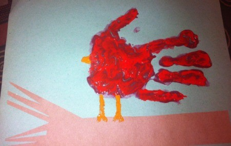 Handprint Winter Cardinals - place a red handprint an inch above the branch, thumb up, add legs and beak with orange paint
