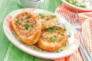 Plate of potato cakes sprinkled with parsley.