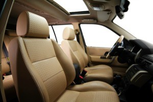 The interior of a car with brown leather seats.