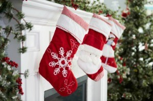 A row of Christmas stocking in red and white.