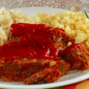 A dinner plate featuring meatloaf.