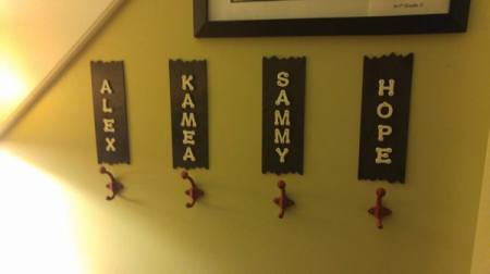 Grandkids' Coat Rack - four individual hooks on wall with child's name on a plaque over the hook