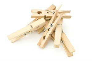A pile of clothespins on a white background.