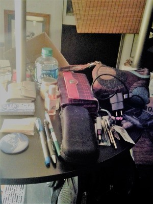 Empty Your Purse for Tidy Living - purse contents on a small table