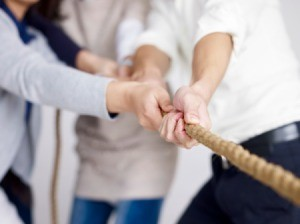 Holding a rope with bare hands.